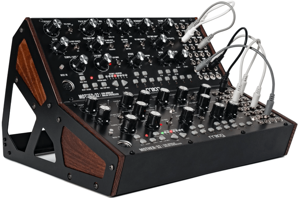 Demonstrates the two-tier rack stand for Moog modules.