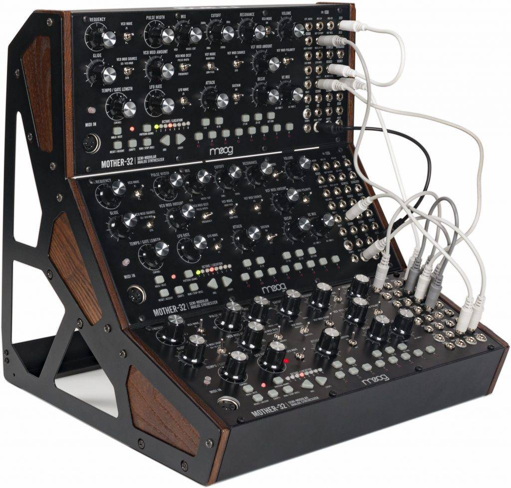 Demonstrates the three-tier stand for Moog semi-modular synthesisers.