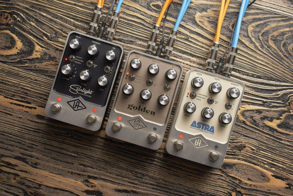 Lifestyle image of all three Universal Audio UAFX pedals.